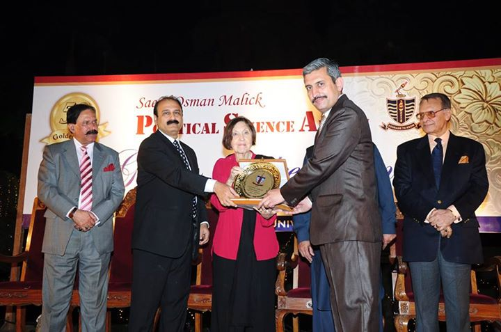 Mr. Ahmed Raza receiving souvenir from the Chief Guest