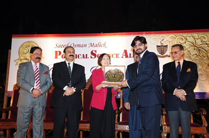 Mr. Sharoon receiving souvenir from the Chief Guest