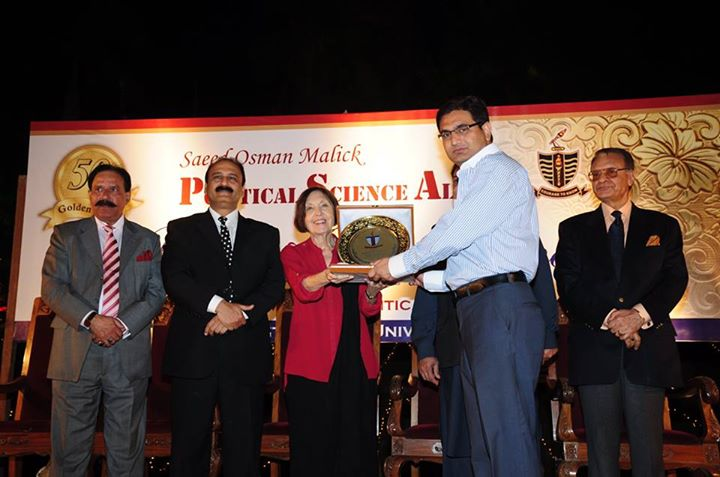 Mr. Ahmed Hayat receiving souvenir from the Chief Guest