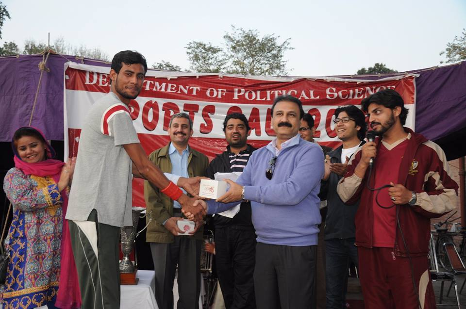 Ahmed Jamal Receiving Player of the Match Award from the Chairperson
