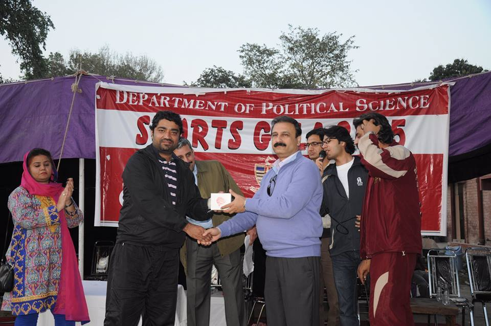 Usman Siddiqi (Organizer) receiving souvenir  from the Chairperson