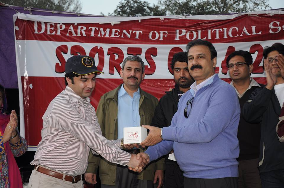 Hanif Ullah Sajid (Match Scorer) receiving souvenir  from the Chairperson