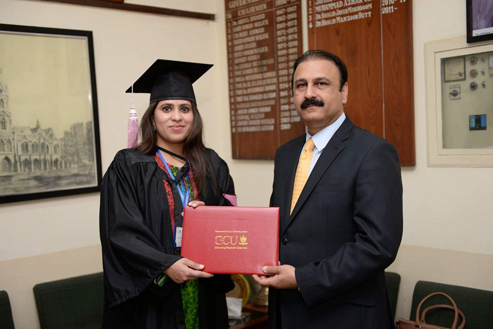 MPhil student receiving degree from chairperson