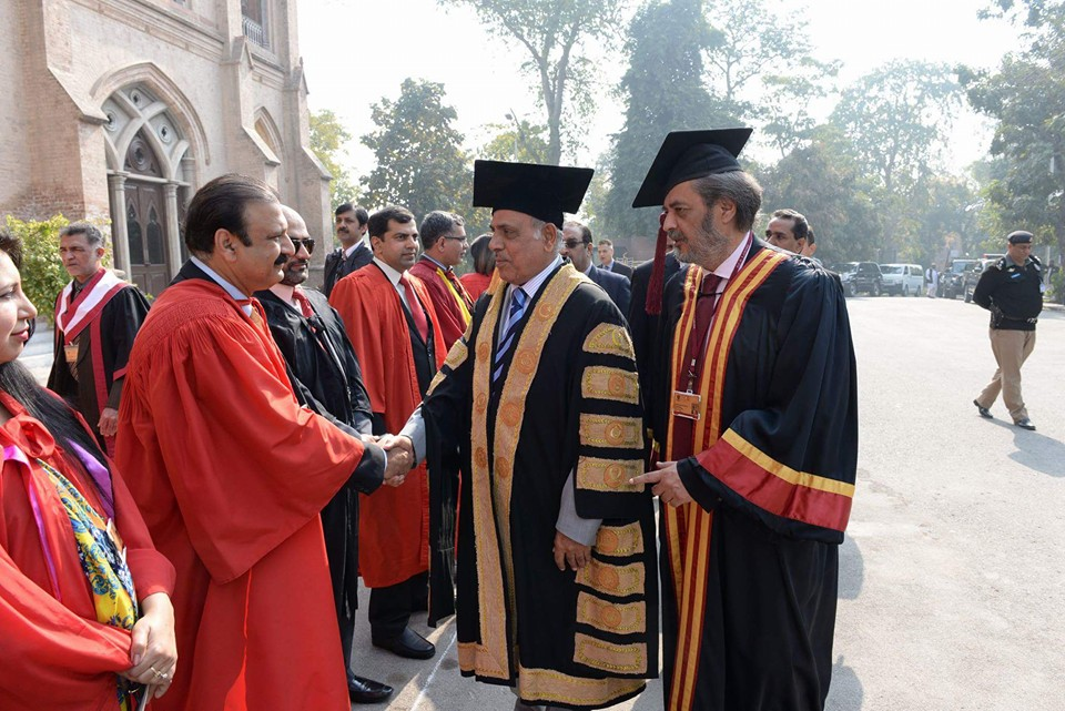 Chairperson shaking hands with Governor Punjab