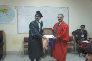 BA Hons student receiving degree from chairperson