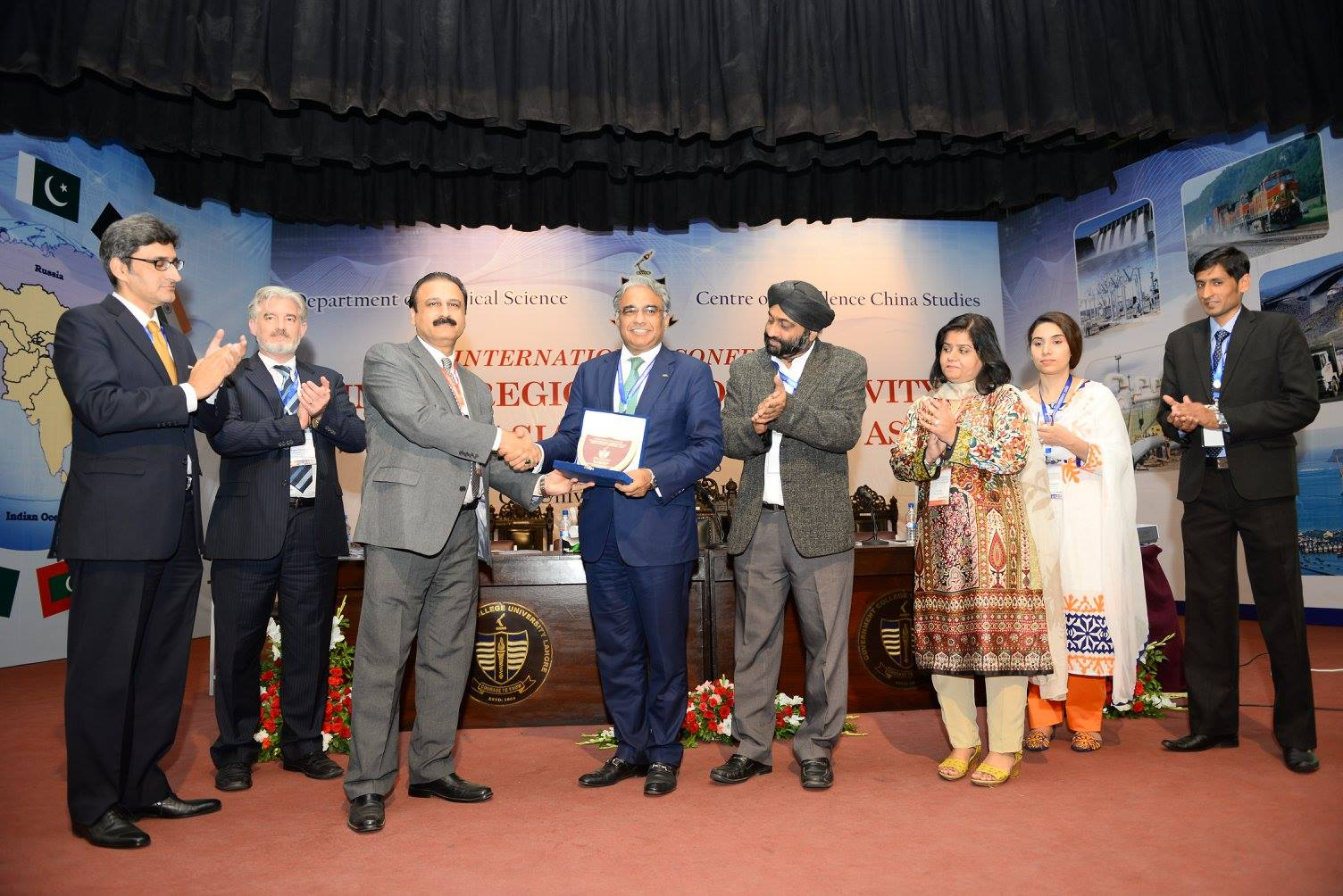 Prof. Dr. Khalid Manzoor Butt presenting souvenir to Speakers